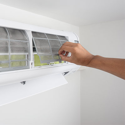 Hand Checking Air Conditioning Unit